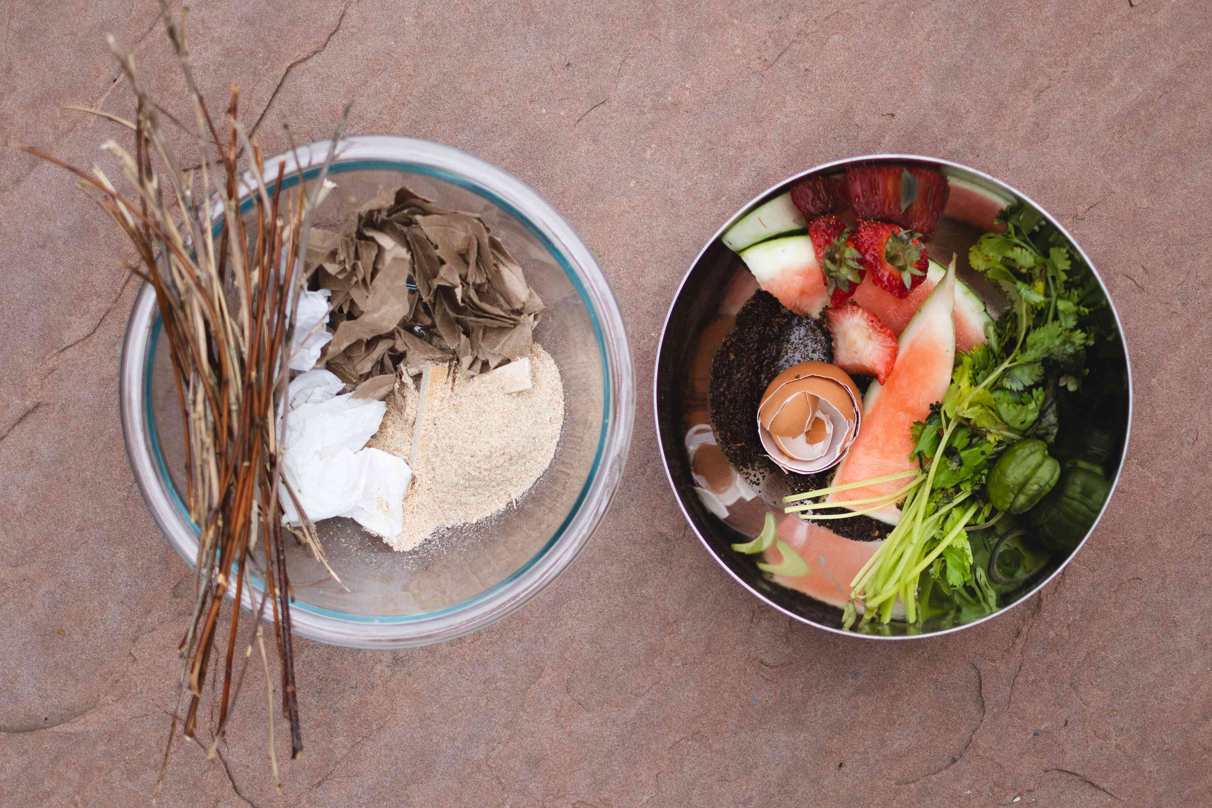 Separate bowls with green and brown material ingredients to make compost