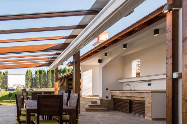 Outdoor kitchen with wood awning