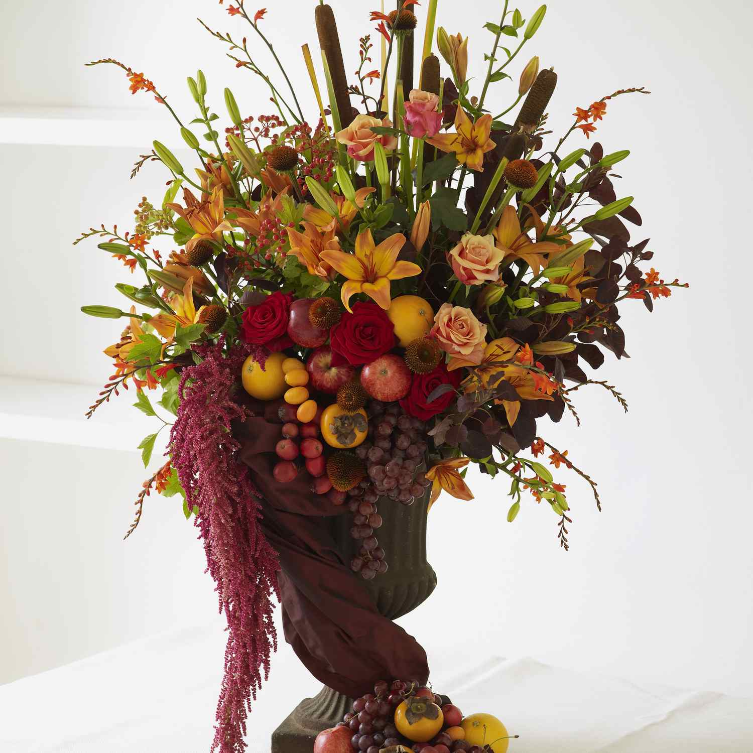 Lily, rose, and fruit fall centerpiece