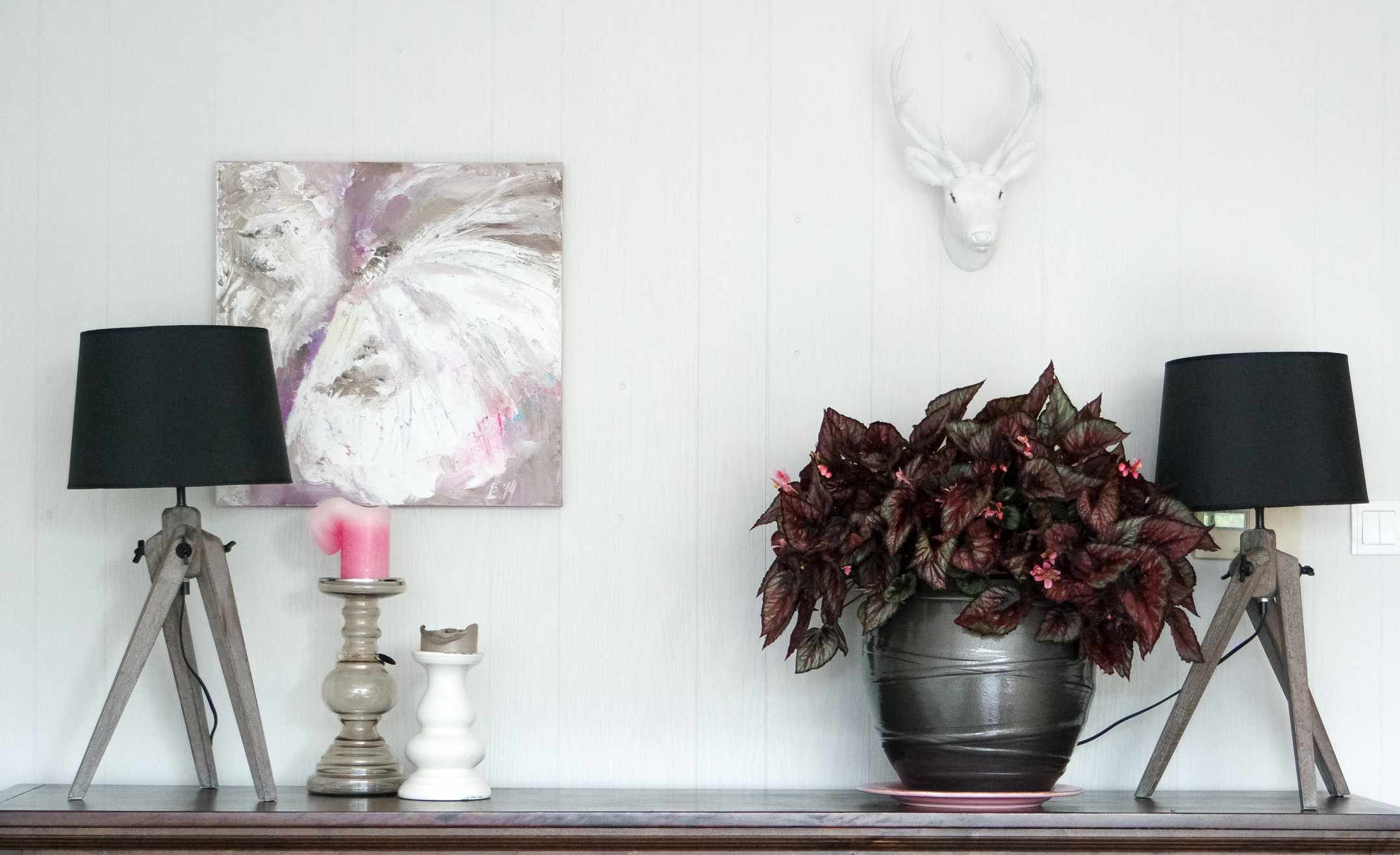 Display with painting and faux taxidermy on a table.