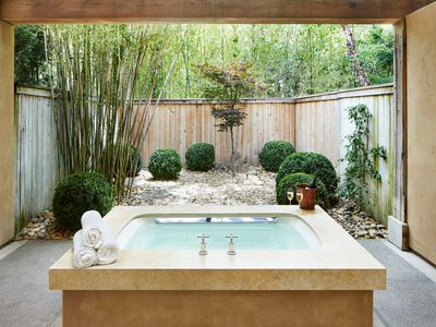 a hot tub centrally placed in a back yard