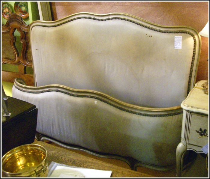 An Antique French Upholstered Bed