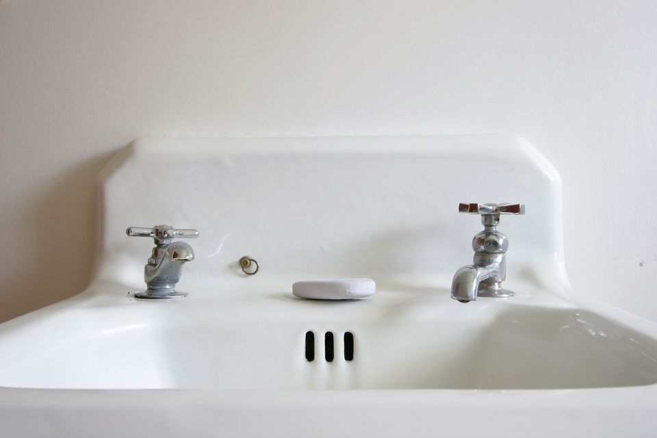 Sink with separate hot and cold faucets