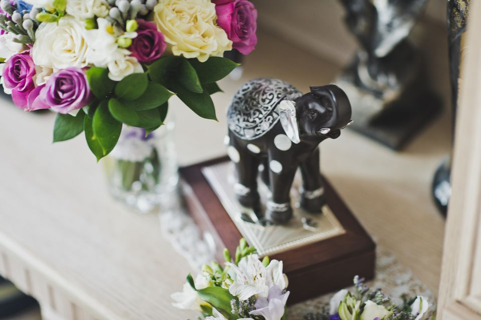 Elephant on table with flowers