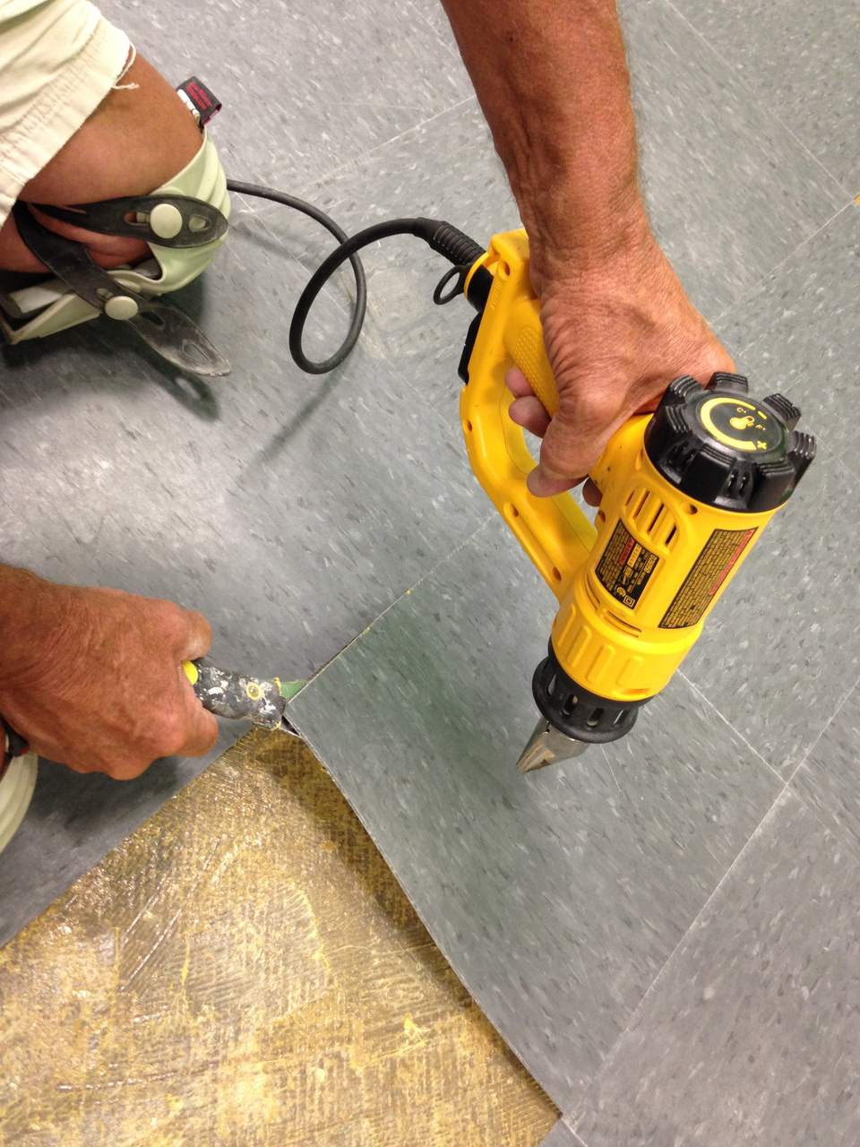 Removing Vinyl Flooring with a Heat Gun