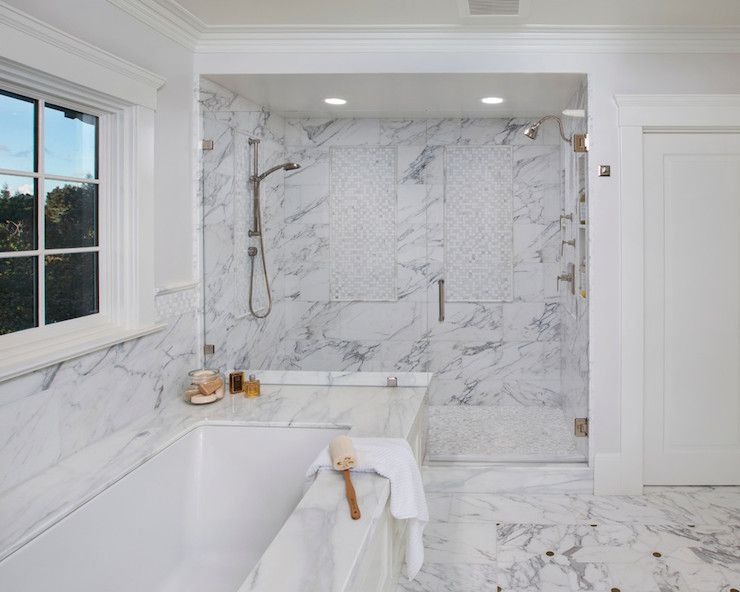 A double shower with marble tile