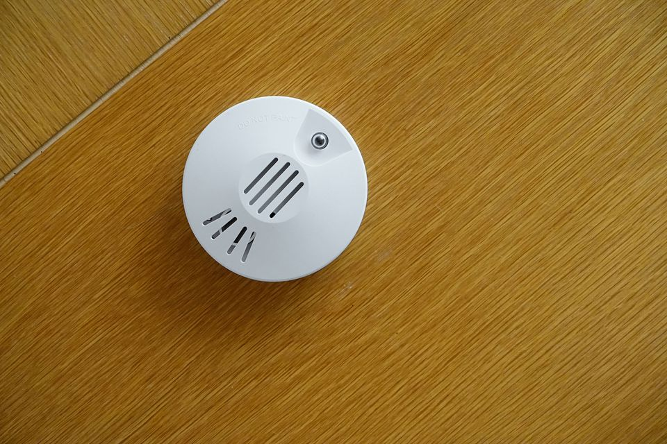 smoke detector on wood ceiling