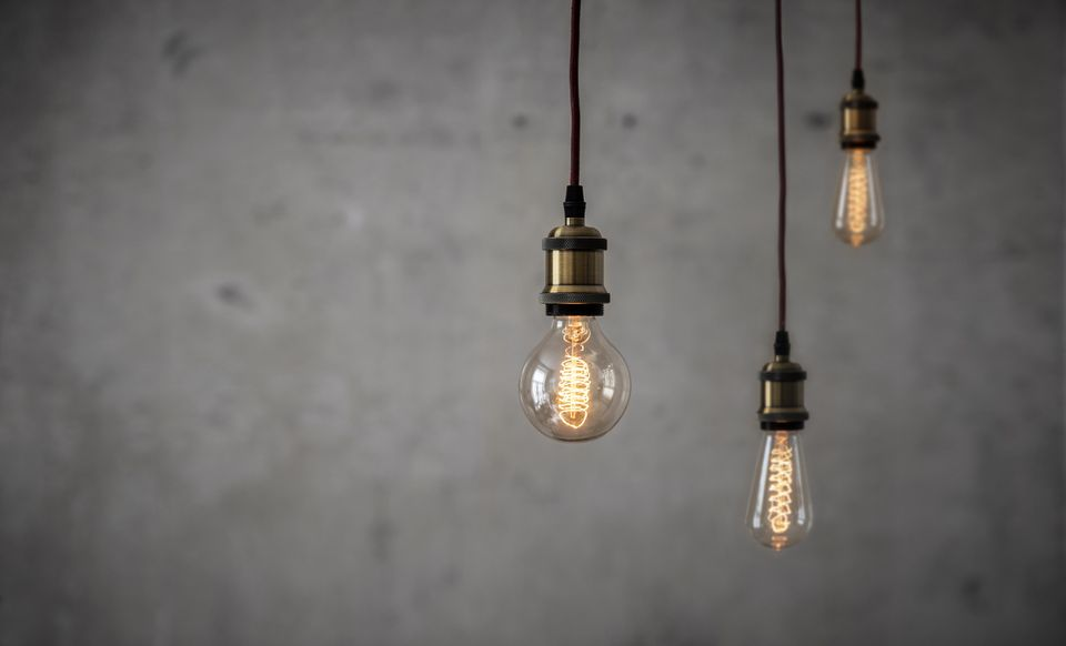 Vintage Edison bulbs in front of concrete wall