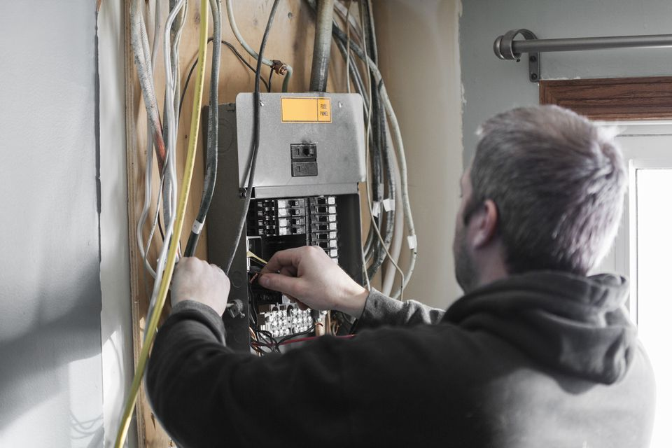 Electrician Upgrading a Homes Distribution Board