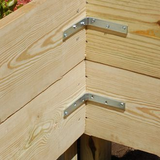 Photo showing how to secure raised garden beds with braces at the corners.