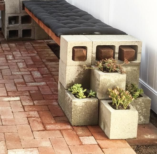 A bench made out of cinder blocks