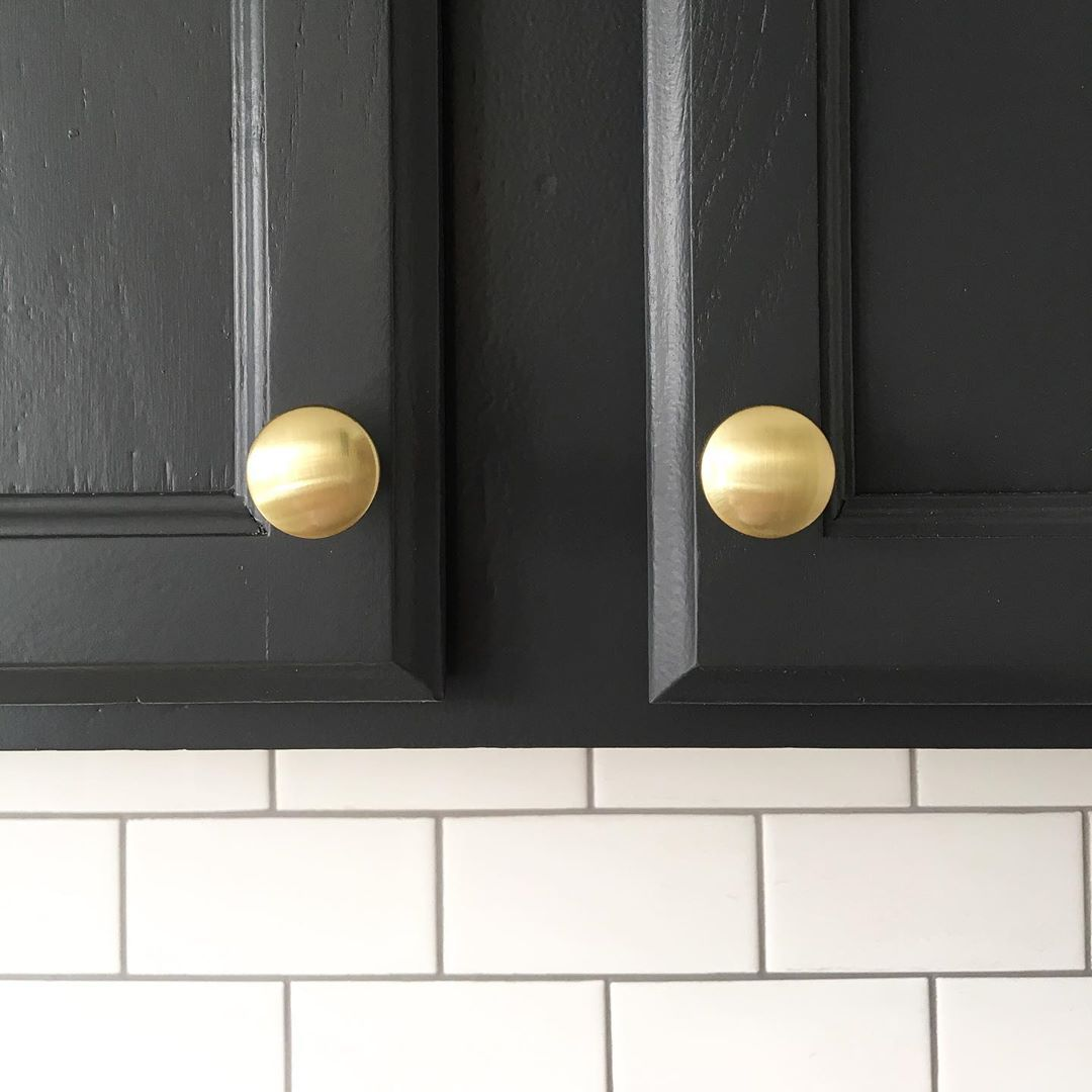 Black cabinet with gold pulls