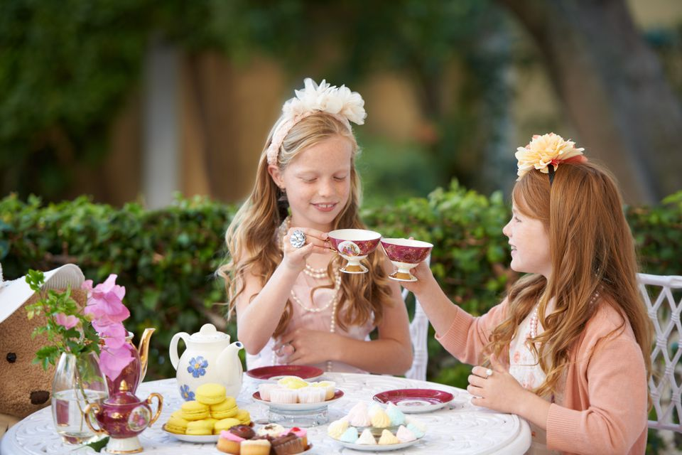 Two girls having a tea party