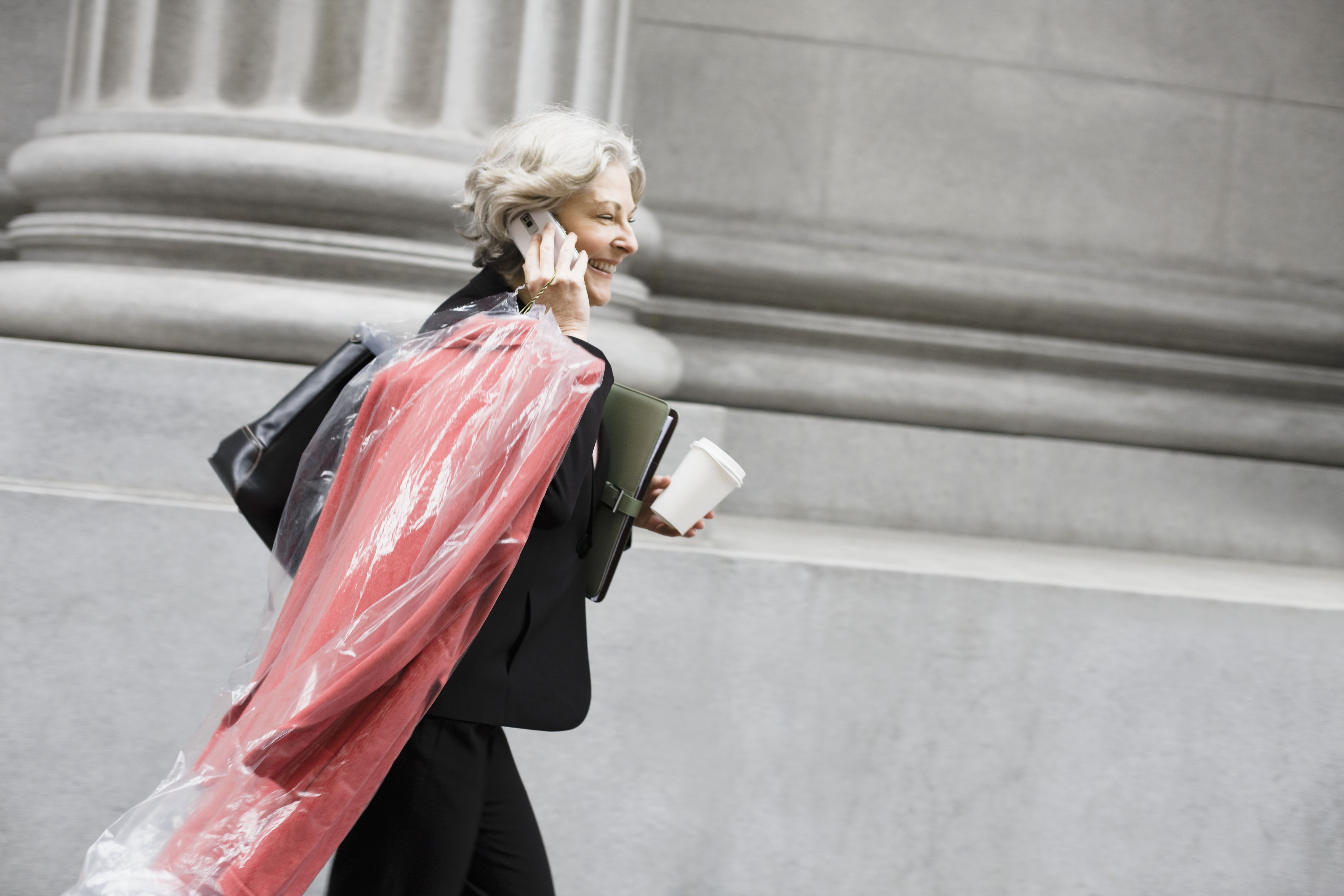 Woman with Dry Cleaning