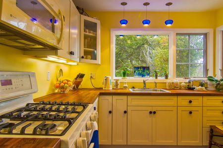 Canary Yellow Walls Cottage Kitchen