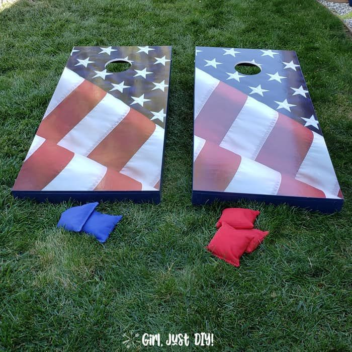 Two cornhole boards decorated with the American flag