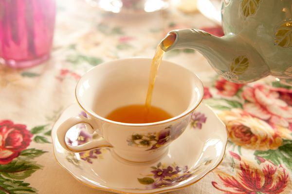 Tea party - Pouring tea into a tea cup