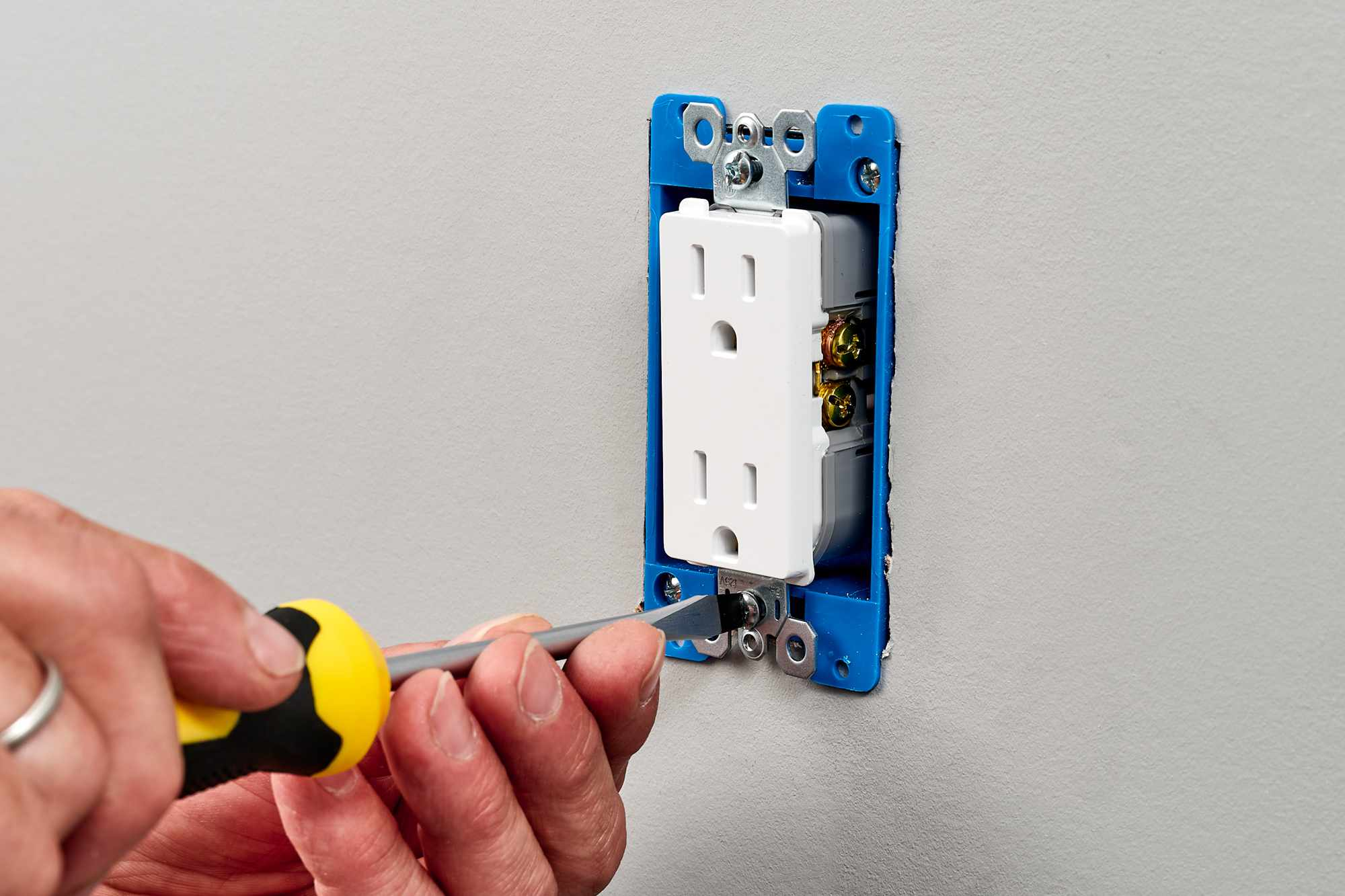 Receptacle pressed into box and secured by threading mounting screws on top and bottom
