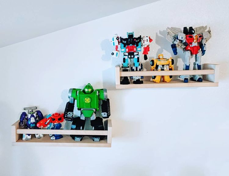 Wall-mounted shelves with toys