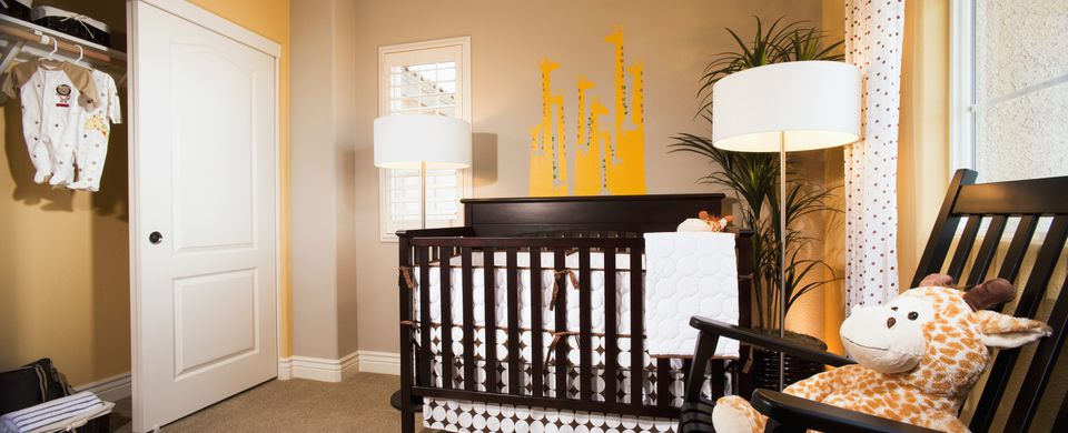 Nursery room crib and lighting