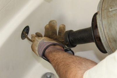 Unclog a Bathtub Drain Using a Snake on paint pouring water in sink, stopped up sink, clogged sink, unclog bathtub, unclog toilet, baking soda unclog bathroom sink, unclog double sink, backed up sink, unclog basement sink, unclog bathroom sink drain, plunging a sink, unclogging bathroom sink, unclog a bathroom sink, unclog tub bathroom, messy bathroom sink, unclog tub drain, cat sink, bleach porcelain sink, unclog sink with disposal, best way to unclog sink,