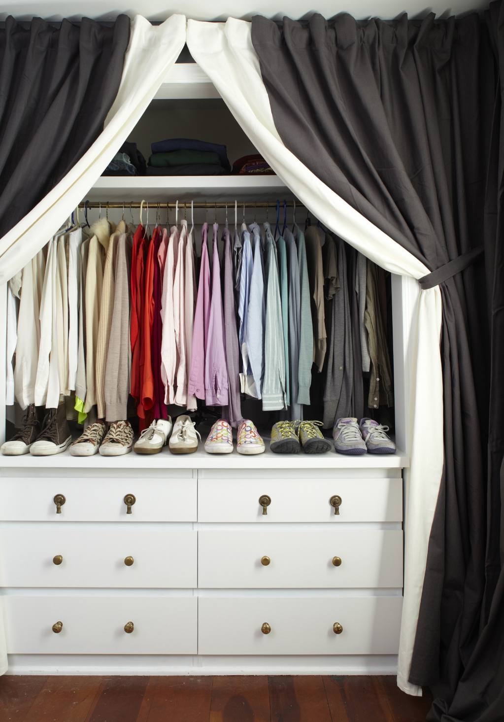 open curtains in front of a closet
