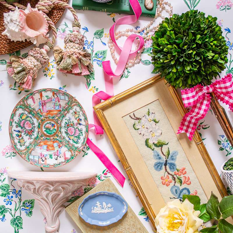 floral patterned art and ceramics on floral tablecloth