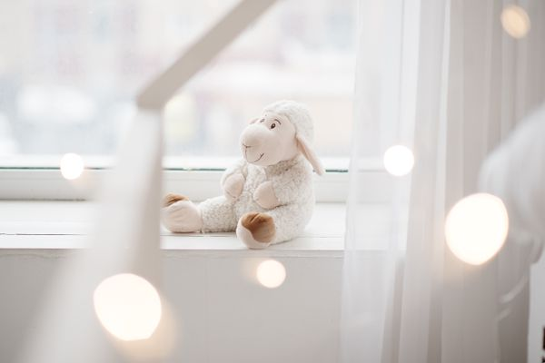 Christmas lantern and toys near frost window