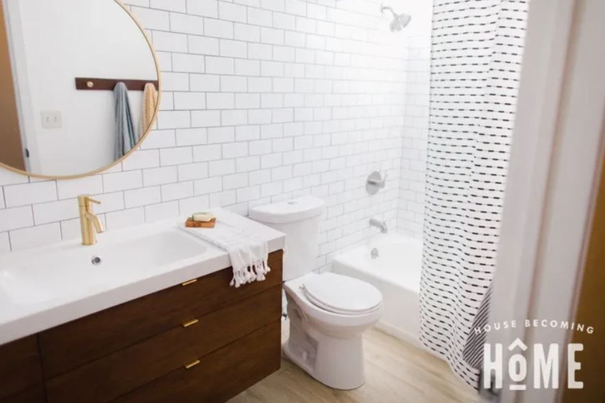 Bathroom with subway tile walls and updated features.