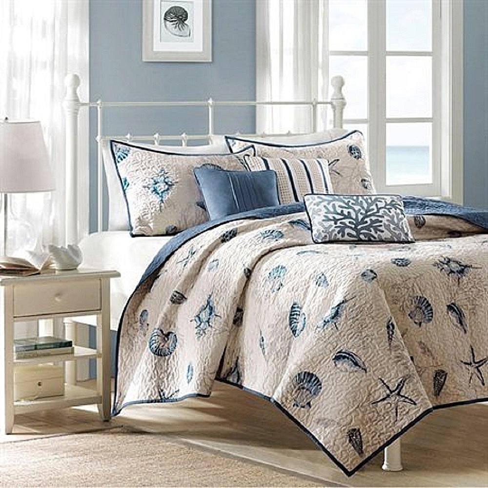 Cute seashell bedding for a coastal-themed bedroom.