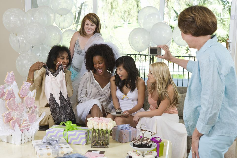 Bride opening gifts at bridal shower.