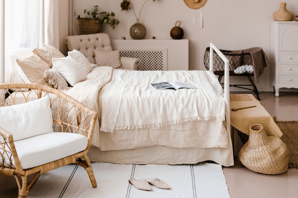 neutral bedroom with rattan accents