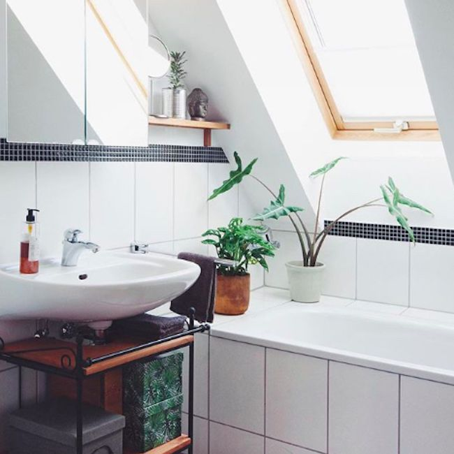 Bathroom with a small window above the tub.