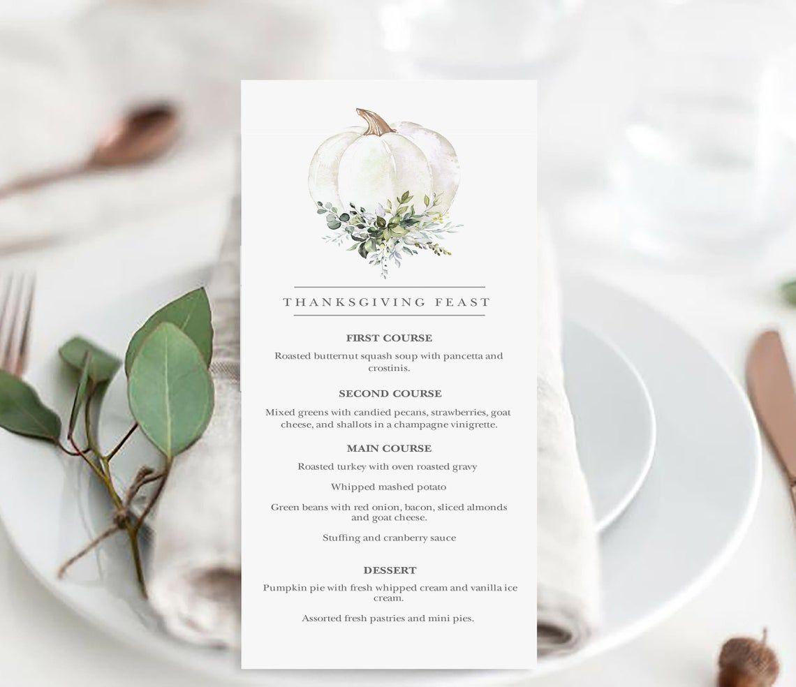 A Thanksgiving feast menu with a white floral pumpkin