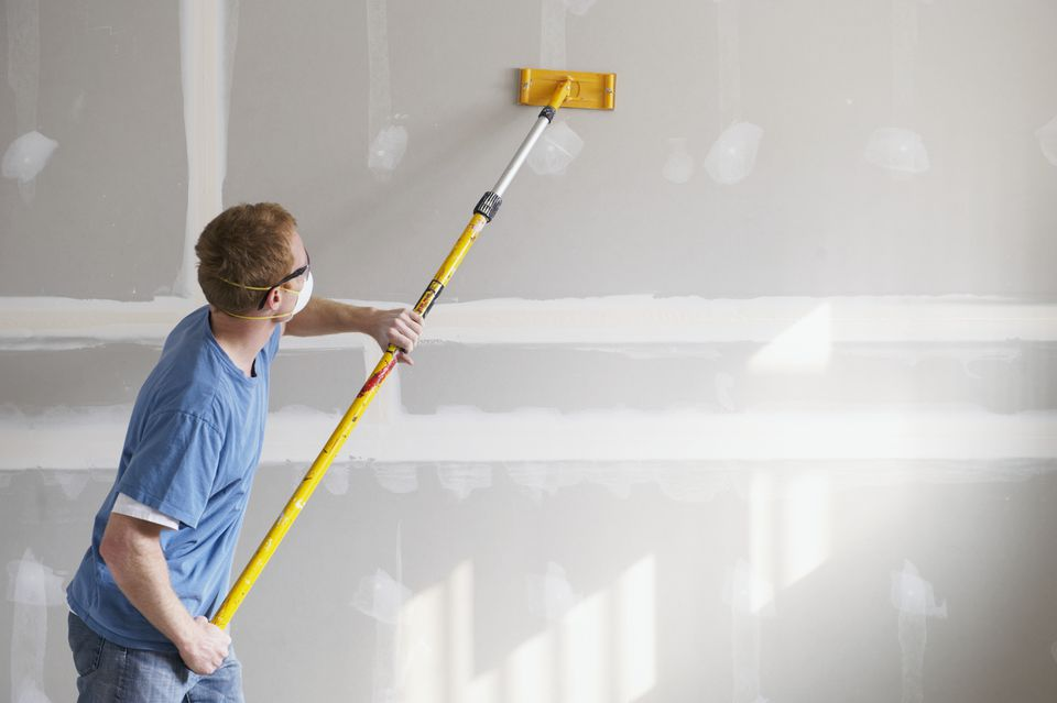 Man sanding drywall