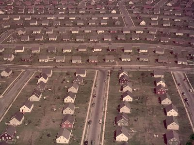 Aerial view of Cape Cod houses that lined streets and cul-de-sac in Levittown, New York, in the 1950s.