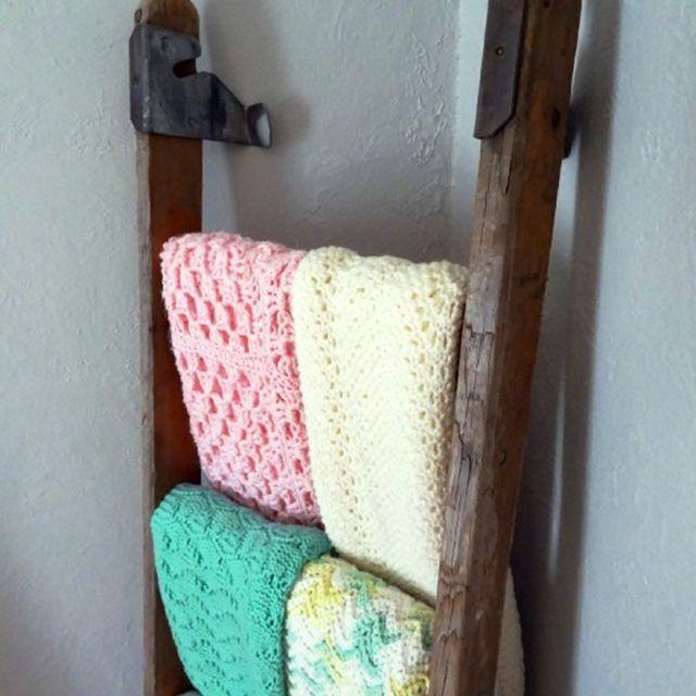 Vintage wooden ladder used to display blankets in the nursery