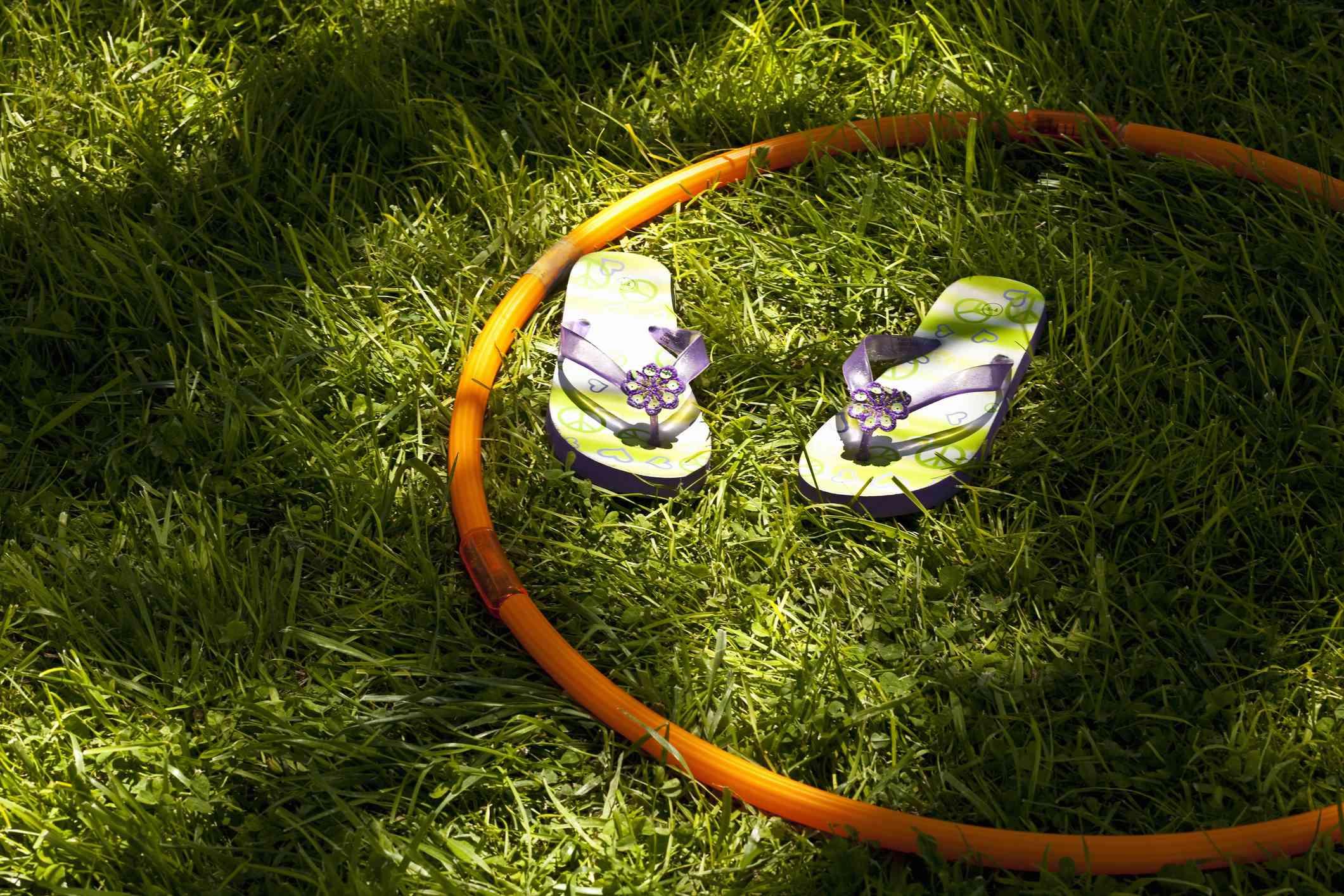 Girls sandals & hula hoop on grass