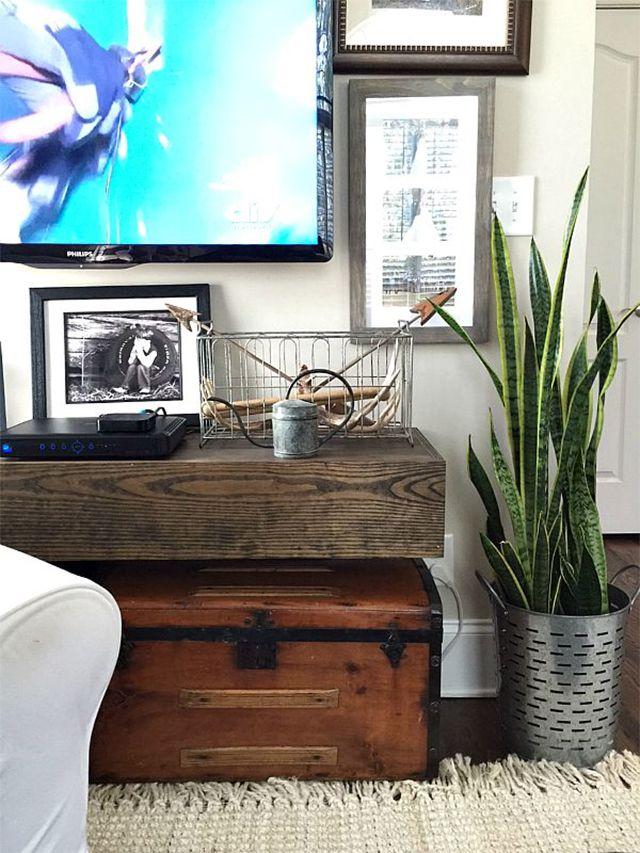 A floating shelf under a TV