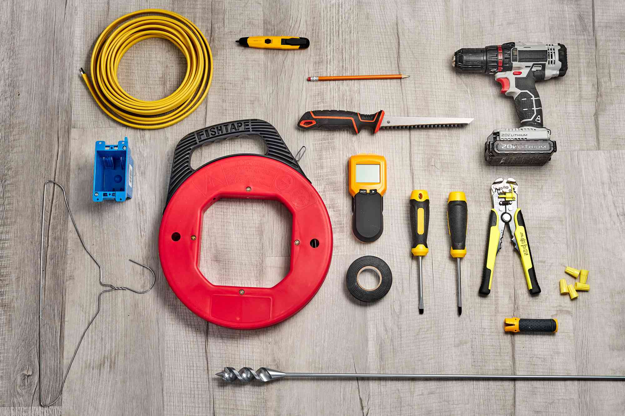 Materials and tools to run electrical wires through a finished wall