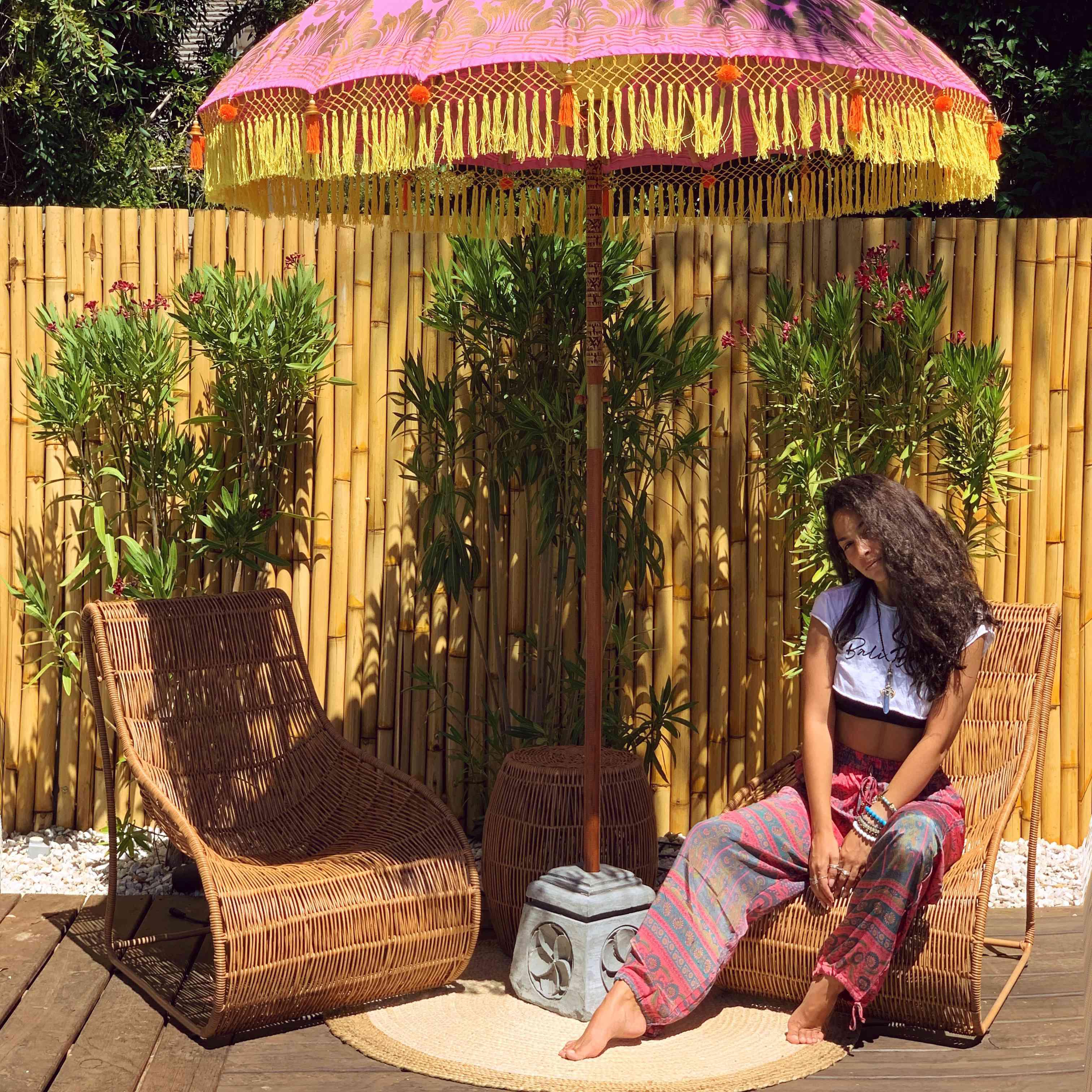 Angelique Velez sitting by her poolside