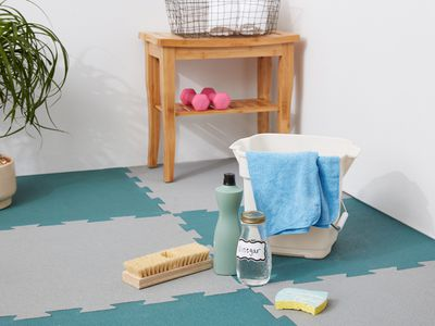 Rubber tile floor with cleaning supplies