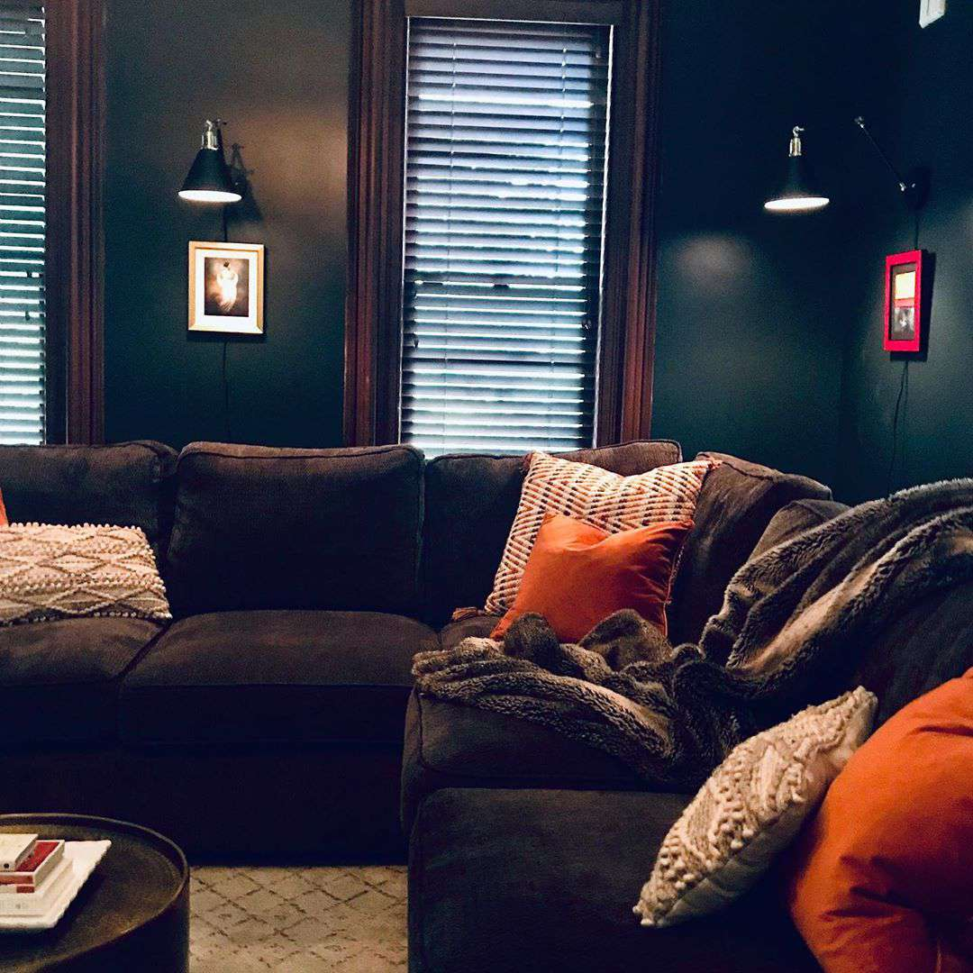 Living room with an oversized brown couch