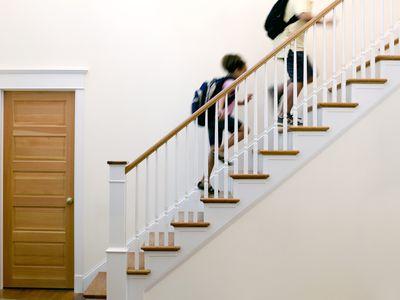 Children running up stairs