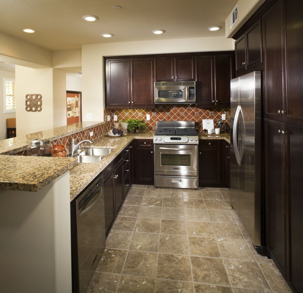 Faux stone linoleum kitchen floor with multicolored features