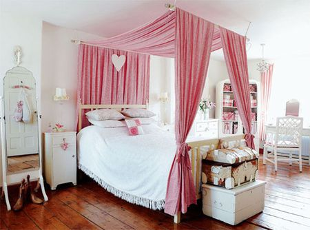 Faux Four Poster Canopy Bed Created Using Curtain Rods