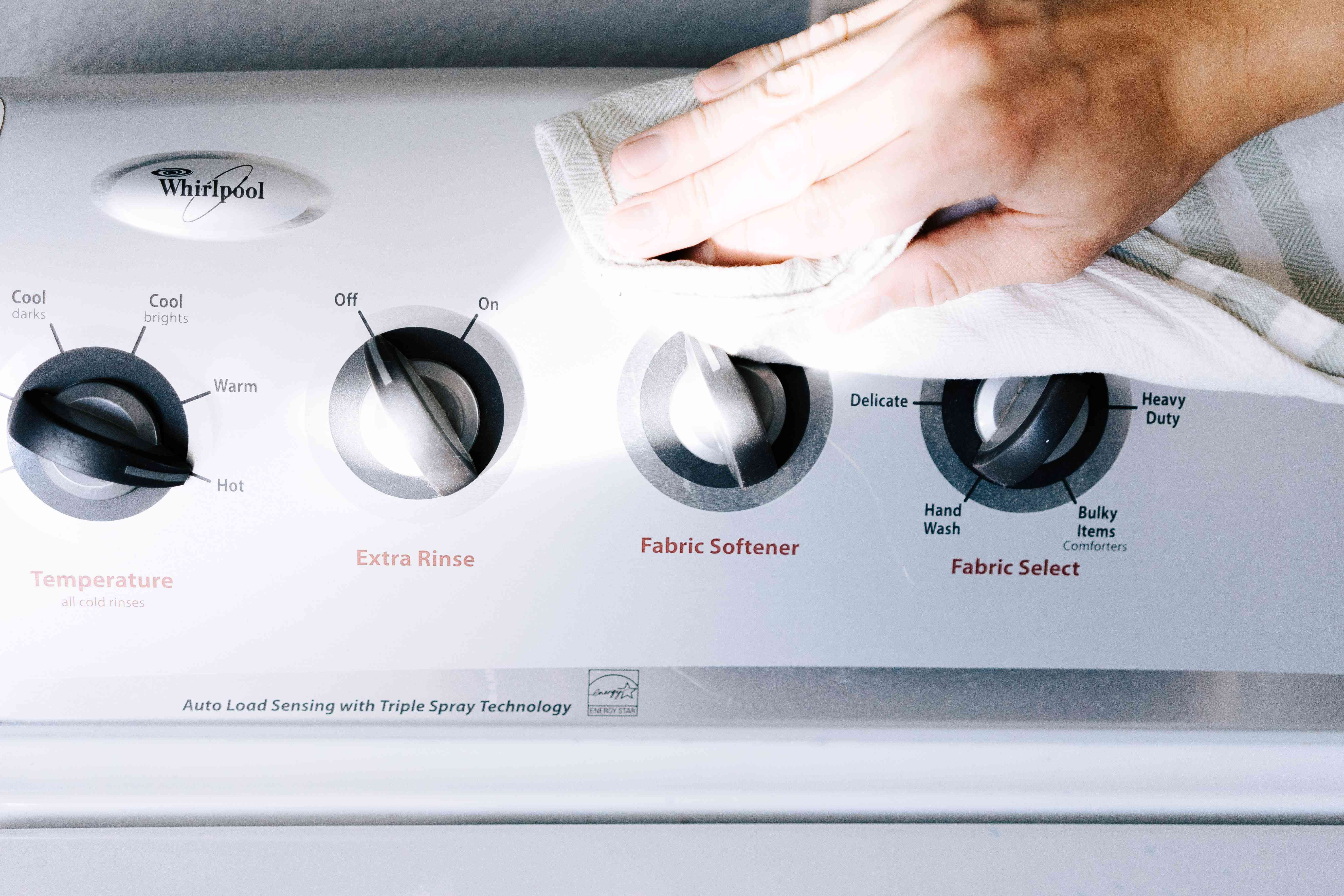 wiping down the outside of the washer