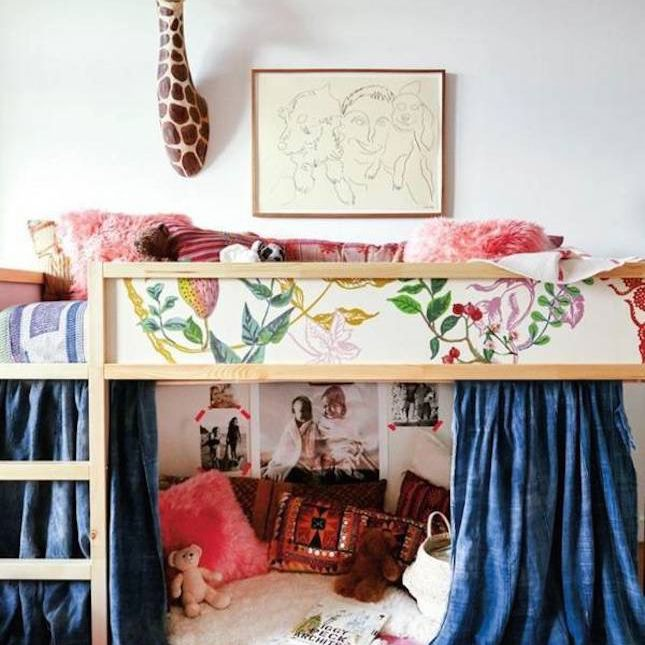 Boho girl's room featuring a loft bed reading nook