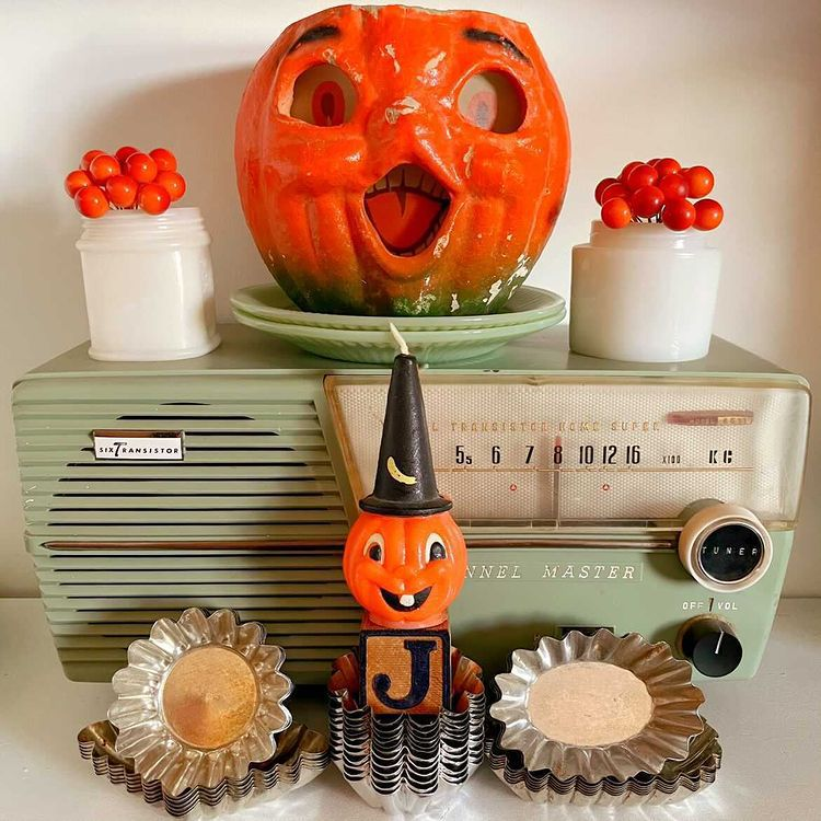 Vintage AM radio and retro Halloween items.