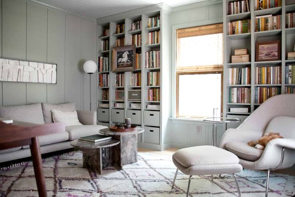 A living room with built-in bookcases